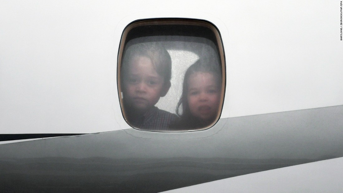 Prince George and Princess Charlotte peer through the window of the plane as they arrive on July 17, in Warsaw, Poland.
