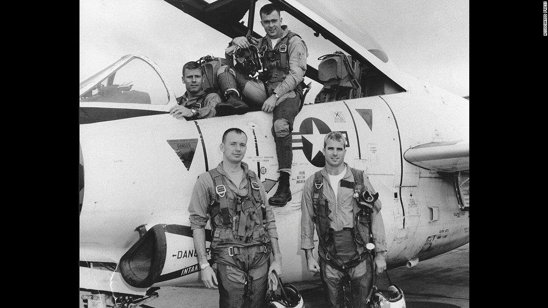 Lt. Cmdr. John McCain poses with his Navy squadron in 1965.