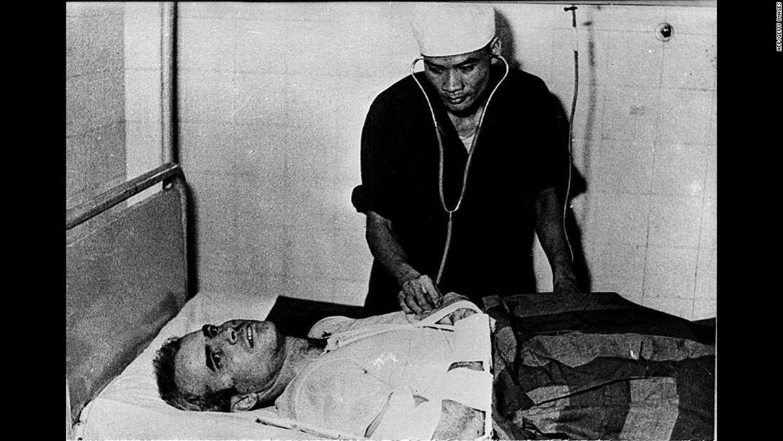 A Vietnamese doctor examines McCain in 1967. For his service and captivity, he earned the Silver Star, Bronze Star, Legion of Merit, Purple Heart, Distinguished Flying Cross Medal and Prisoner of War Medal.