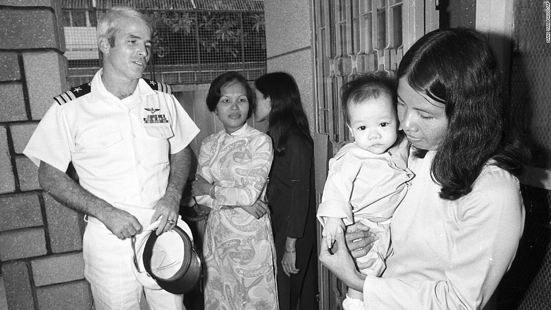 A year after his release, McCain visits the Holt orphanage in Saigon, Vietnam, as a guest of the South Vietnamese government.