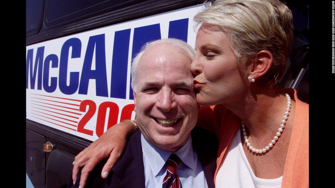 McCain gets a kiss from his wife as they kick off his campaign for the 2000 presidential election.