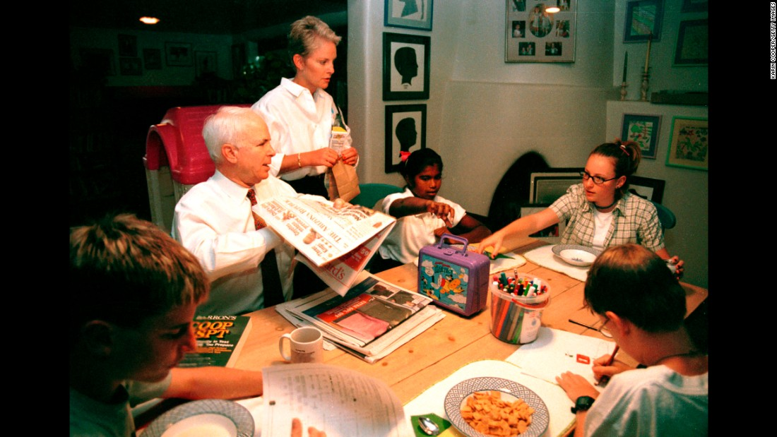McCain visits on October 14, 1999, with his wife, Cindy, and their children at home in Phoenix. Their daughters are Meghan, right, and Bridget, with sons Jack and Jimmy.