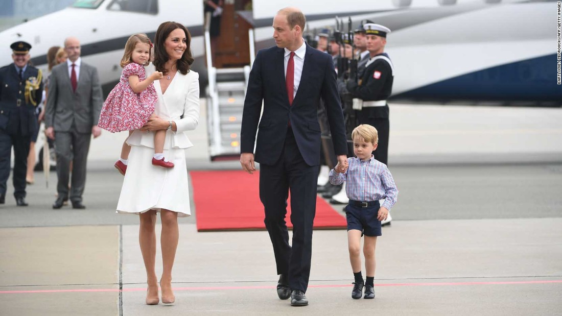 The royal couple disembarks with their children upon arrival on July 17, at the airport in Warsaw, Poland.