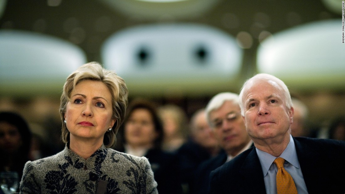 McCain and fellow US Sen. Hillary Clinton listen to President George W. Bush speak at the National Prayer Breakfast in 2007.
