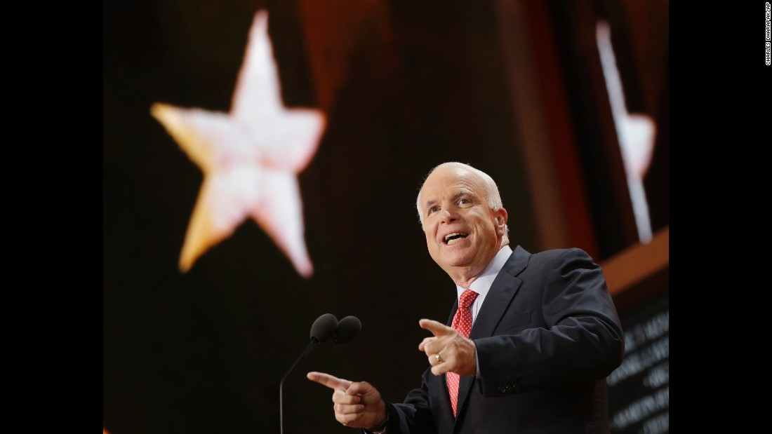 McCain gestures as he walks to the lectern on August 29, 2012, during the Republican National Convention in Tampa, Florida.