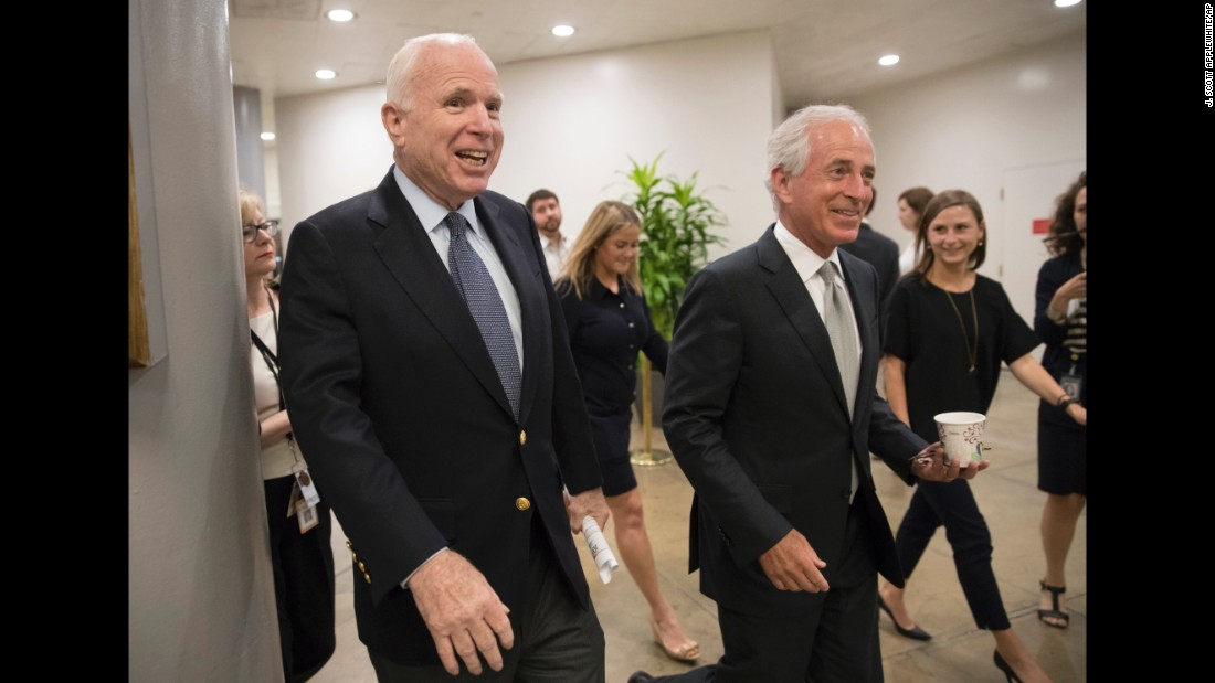 McCain, left, and Sen. Bob Corker, R-Tennessee, head to the Senate chamber on July 13, 2017, on Capitol Hill in Washington, for a meeting on the revised Republican health care bill. The measure had been under attack from within the party.