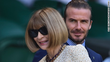 David Beckham and journalist and editor Anna Wintour arrive to take their seats in the Royal Box on Centre Court at Wimbledon.