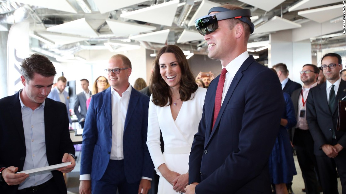 William wears virtual-reality goggles as Kate laughs during a meeting with young Polish entrepreneurs in Warsaw, Poland.