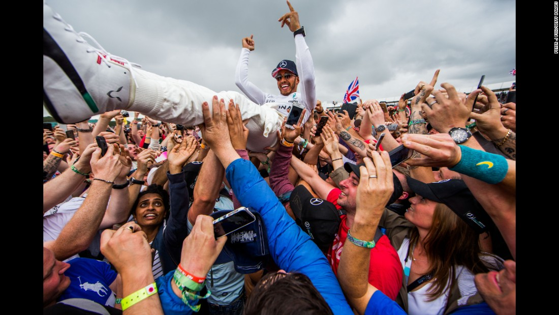 "Lewis Hamilton of Mercedes and Great Britain celebrates after <a href=""http://bleacherreport.com/articles/2721938-lewis-hamilton-wins-2017-british-f1-grand-prix-after-punctures-collapse-ferrari"" target=""_blank"">winning the Formula One Grand Prix of Great Britain</a> at Silverstone on Sunday, July 16, in Northampton, England."