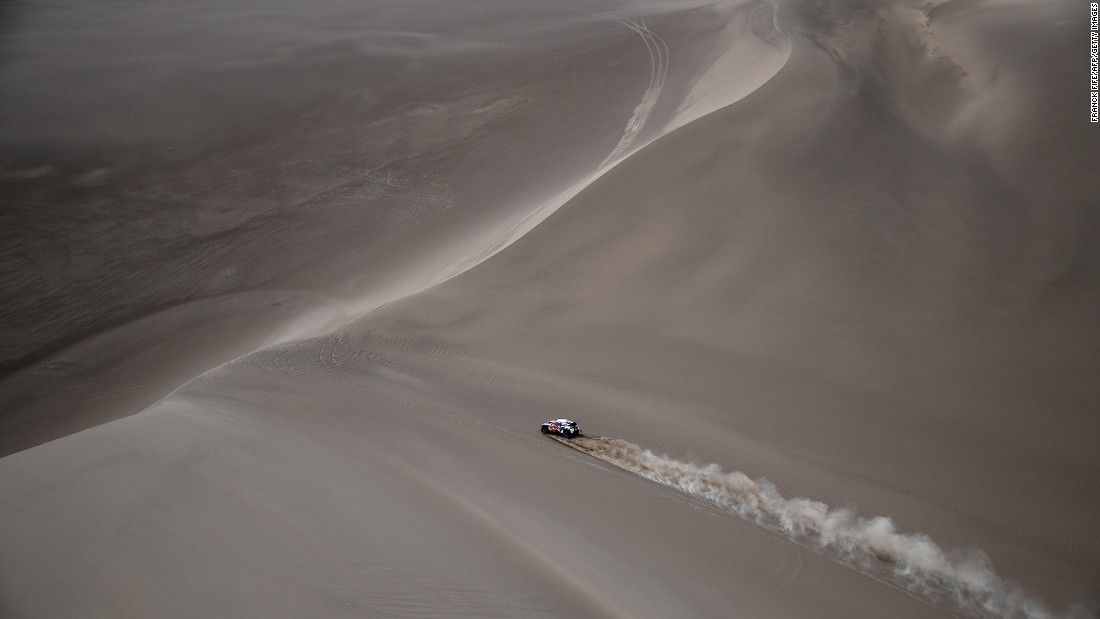 The car of Sebastien Loeb and Daniel Elena races in the Silk Way 2017 between Urumqi and Hami, China, on Monday, July 17.