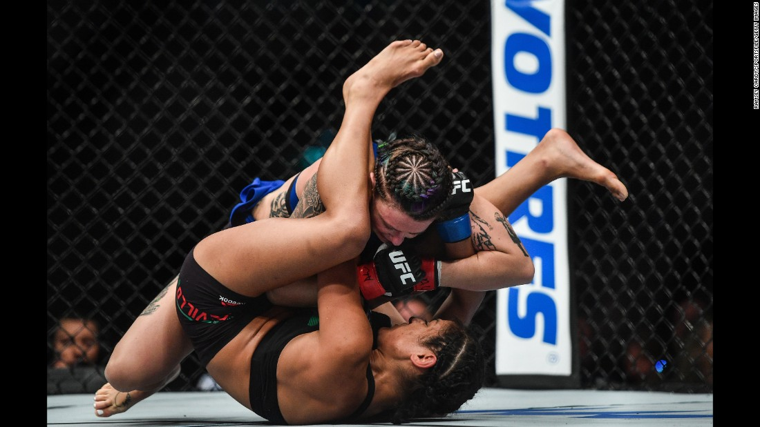 Joanne Calderwood, above, fights Cynthia Calvillo during their strawweight bout at UFC Fight Night Glasgow on Sunday, July 16.