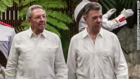 Colombian President Juan Manuel Santos (R) is welcomed by his Cuban counterpart Raul Castro at Revolution Palace in Havana, on July 17, 2017. Santos is in Cuba for a two-day official visit. / AFP PHOTO / Adalberto ROQUE        (Photo credit should read ADALBERTO ROQUE/AFP/Getty Images)