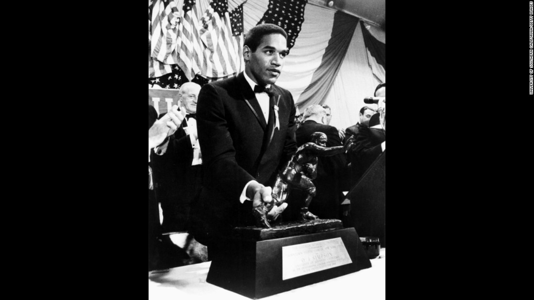 As a University of Southern California running back, Simpson accepts the Heisman Trophy in December 1968.