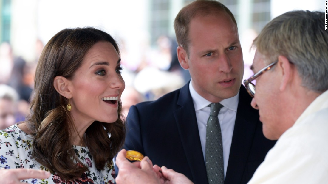 Kate and William are shown a piece of amber by a local craftsman during a visit on July 18, to the Gdansk central market in Poland.