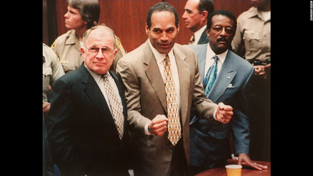 Simpson cheers with his attorneys F. Lee Bailey, left, and Johnnie Cochan Jr. on October 3, 1995, after being found not guilty of killing Nicole Brown Simpson and Ronald Goldman. Though cleared of criminal charges, a civil jury later slapped the former football star with a $33 million wrongful death judgment, and attorneys for the Goldman family have doggedly pursued his assets.