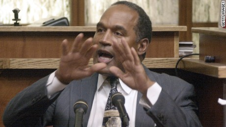 "396237 06: Former NFL Star and Actor O.J. Simpson is being sworn in during the second day of his ""road rage"" trial in a Miami-Dade County Courtroom October 22, 2001 in Miami, FL. Simpson is on trial for allegedly attacking a Miami motorist in December 2000. If found guilty, Simpson faces up to 16 years in prison. (Pool Photo/Getty Images)"