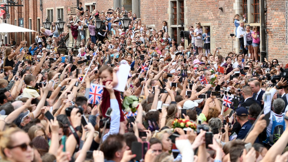 A crowd lines the street to greet the royal couple during their visit to Gdansk, Poland.