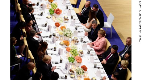 Putin sat next to first lady Melania Trump at the G20 dinner.