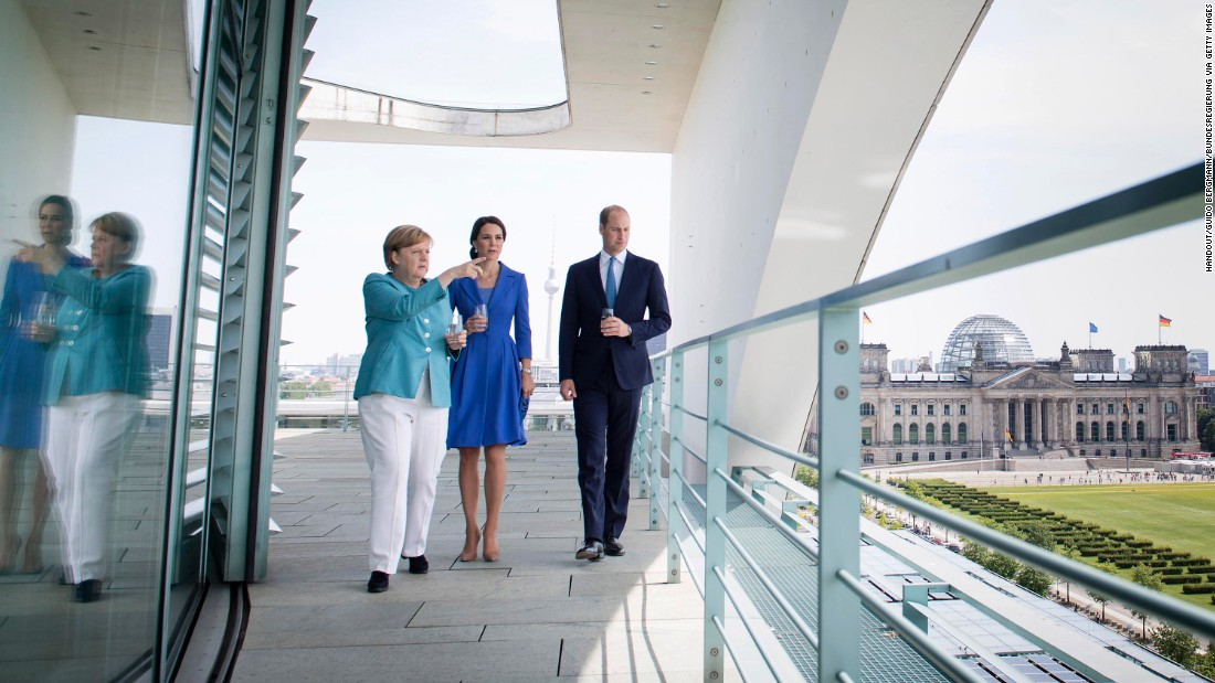 German Chancellor Angela Merkel shows William and Kate a view from the Federal Chancellery on July 19, in Berlin, in this In this handout photo from the German government's press office.
