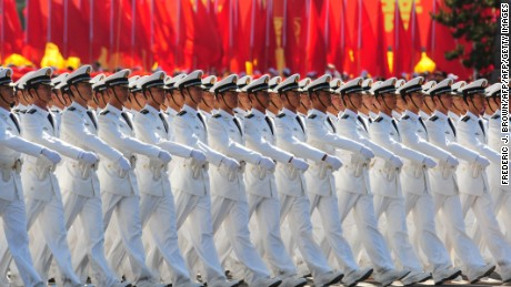 Chinese People's Liberation Army (PLA) naval officers march pass Tiananmen Square during the National Day parade in Beijing on October 1, 2009.