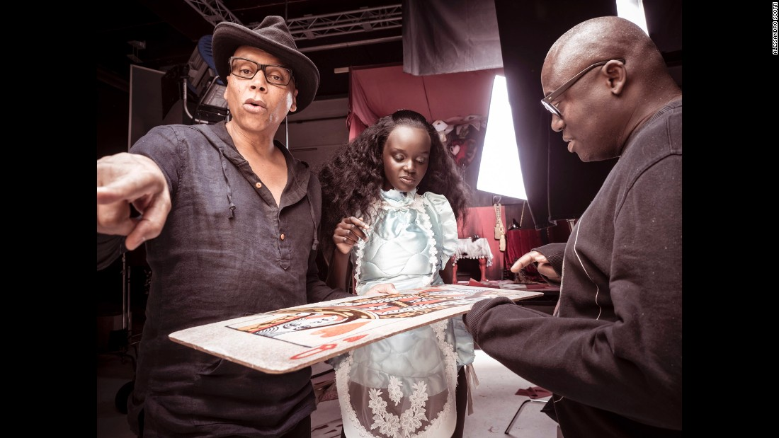Models RuPaul and Duckie Thot join British Vogue editor Edward Enninful  in preparing for the shoot.