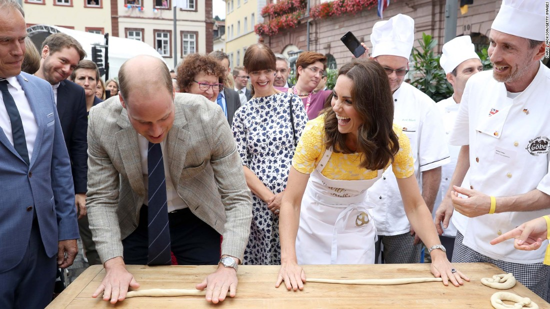 William and Kate attempt to make pretzels on July 20, during a tour of Heidelberg's traditional German market.