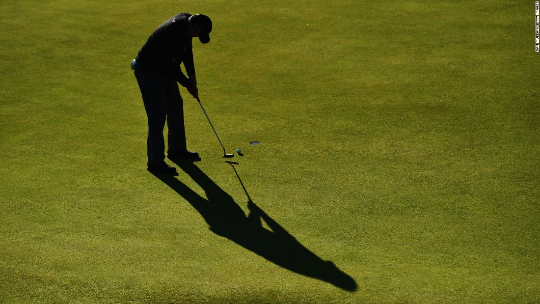 Paul Lawrie of Scotland putts on the 17th green.