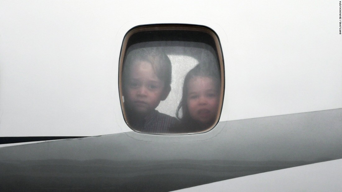 "Britain's Prince George, left, and Princess Charlotte look through an airplane window as they arrive in Warsaw, Poland, with their parents -- Prince William, Duke of Cambridge, and Catherine, Duchess of Cambridge -- on Monday, July 17. The two were accompanying their parents on a <a href=""http://www.cnn.com/2017/07/17/world/gallery/royals-visit-poland-germany-2017/index.html"" target=""_blank"">five-day visit to Poland and Germany</a>."