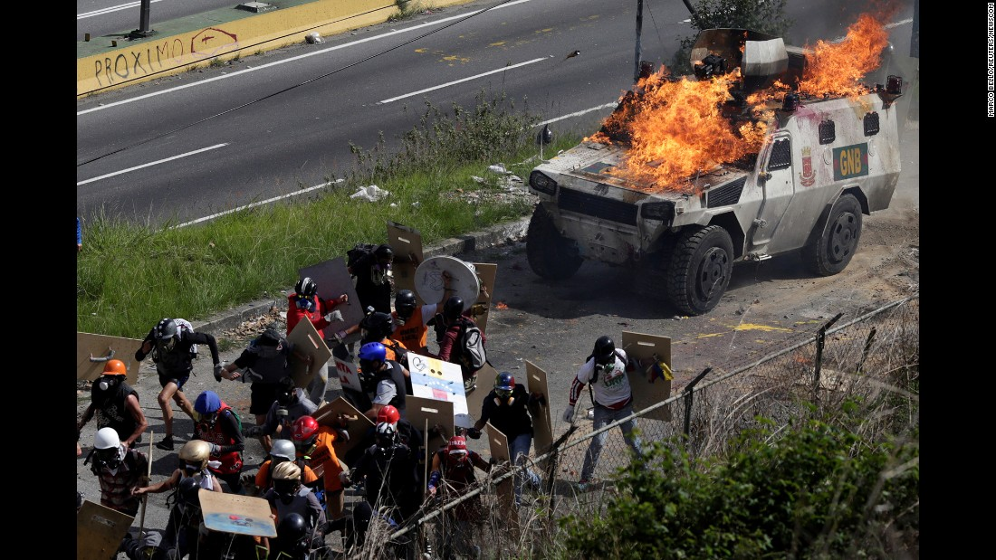 "An armored vehicle is lit on fire during clashes at a rally against Venezuelan President Nicolas Maduro's government in Caracas, Venezuela, on Tuesday, July 18. Nearly 7.2 million Venezuelans <a href=""http://edition.cnn.com/2017/07/17/americas/venezuela-referendum-votes/index.html"" target=""_blank"">took part in a nonbinding referendum</a> on Sunday, July 16, organized by the country's main opposition parties, with the overwhelming majority of voters coming out against the government's  plans to rewrite the country's constitution. The government has condemned the referendum as illegal, and has instead called for a July 30 vote to elect a special assembly to rewrite the 1999 constitution."