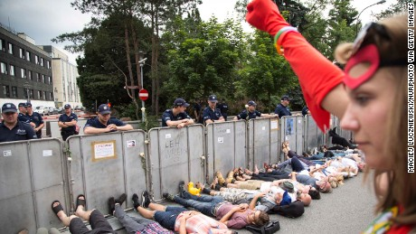 Protesters lay under barriers near Polish parliament.