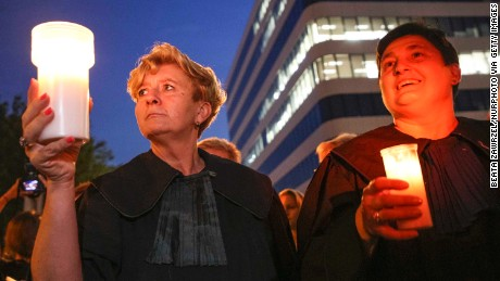 "Judges join protests at a ""Chain of Light"" rally in Krakow."