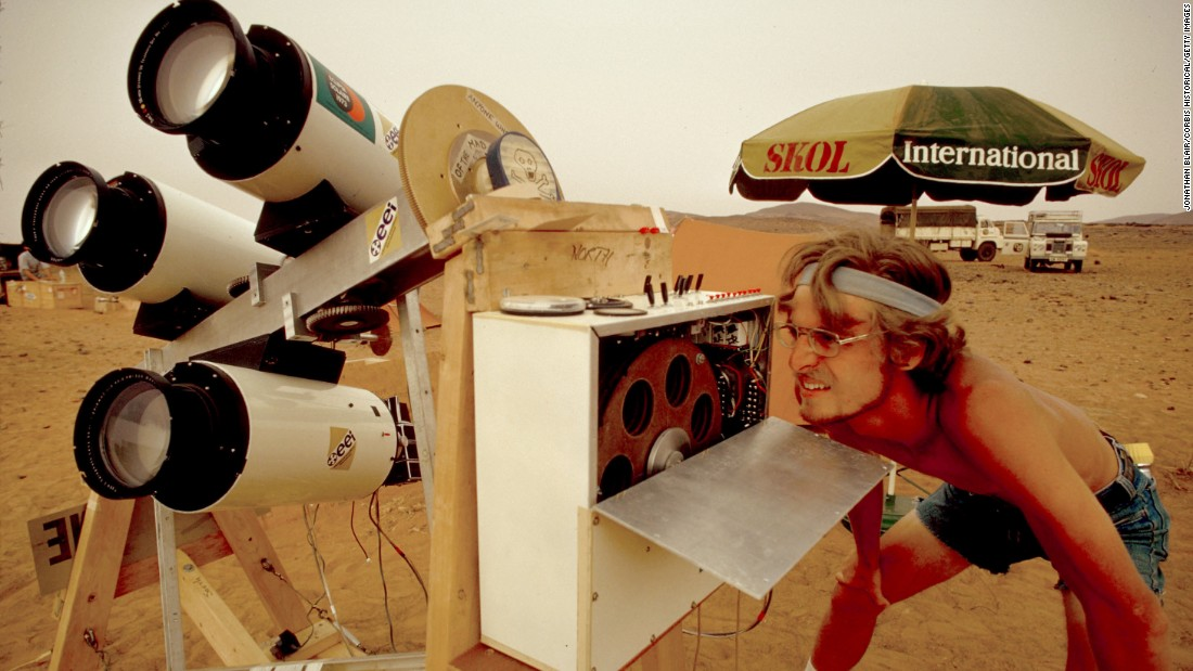 An astronomer with Educational Expedition International in Mauritania's desert uses astronomical equipment to view a total solar eclipse in 1973.