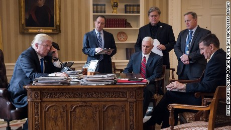 WASHINGTON, DC - JANUARY 28: President Donald Trump speaks on the phone with Russian President Vladimir Putin in the Oval Office of the White House, January 28, 2017 in Washington, DC. Also pictured, from left, White House Chief of Staff Reince Priebus, Vice President Mike Pence, White House Chief Strategist Steve Bannon, Press Secretary Sean Spicer and National Security Advisor Michael Flynn. On Saturday, President Trump is making several phone calls with world leaders from Japan, Germany, Russia, France and Australia. (Photo by Drew Angerer/Getty Images)