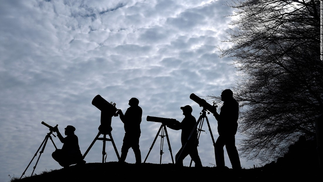 Members of the Galloway Forest Astronomical Society prepare their equipment ahead of the solar eclipse on March 19, 2015 in Newton Stewart, Scotland.