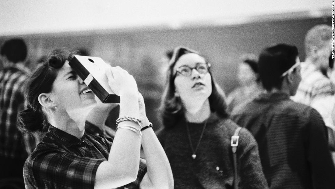 Students using the pinhole technique to view the solar eclipse on February 27, 1958.