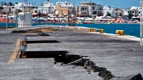 Cracks are seen at the main port on the island of Kos on July 21, 2017, following a 6.5 magnitude earthquake which struck the region. 
