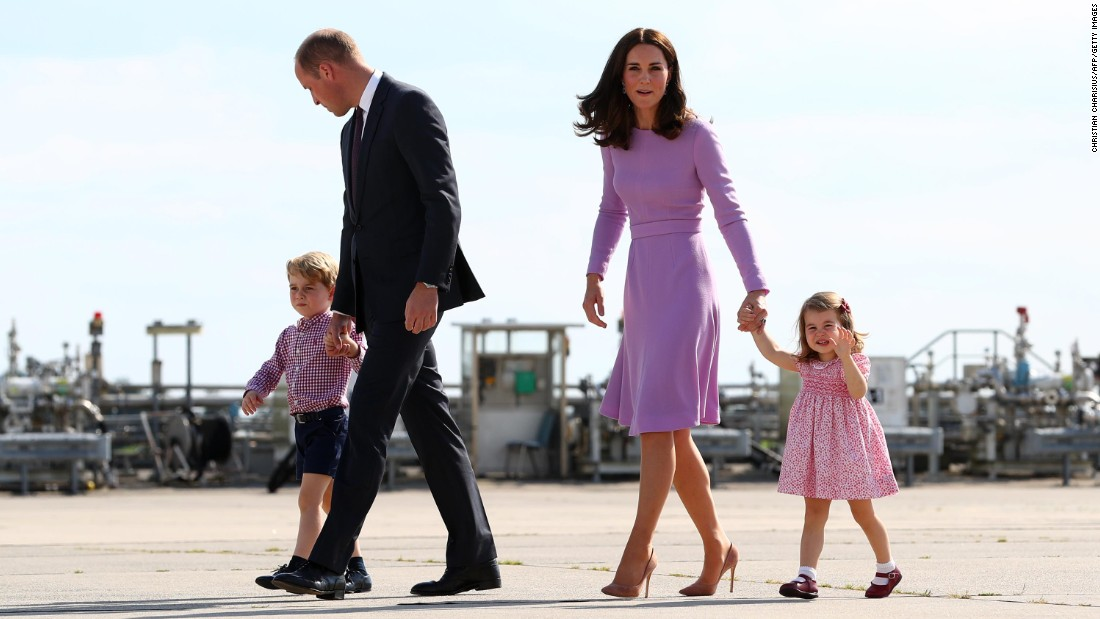 Britain's Prince William, Duke of Cambridge, and his wife Catherine, Duchess of Cambridge, and their children Prince George and Princess Charlotte walk on the tarmac of the Airbus compound in Hamburg, northern Germany, before boarding their plane on Friday, July 21. The royal family visited Germany and Poland on a five-day European tour.
