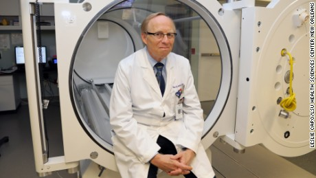 Dr. Paul Harch sitting in the hyperbaric oxygen therapy chamber.