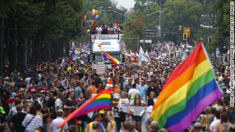 Paradegoers march alongside decorated trucks on Saturday during the 2017 Christopher Street Day gay pride celebration in Berlin, Germany.