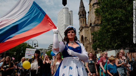 The parade saw people of all nationalities -- like this participant from Russia -- join the festivities.