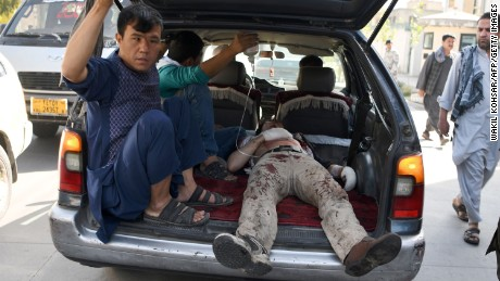 An injured man is transported after a car bomb attack in western Kabul, Afghanistan, on Monday, July 24.