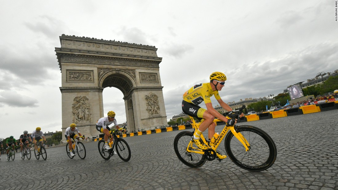 Against the backdrop of the Arc de Triomphe, Britain's Chris Froome rides to his fourth Tour de France win.