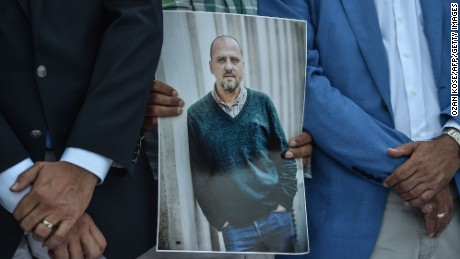 A man holds a portrait of jailed investigative journalist Ahmet Sik on July 24, 2017 during a demonstration outside Istanbul's courthouse.