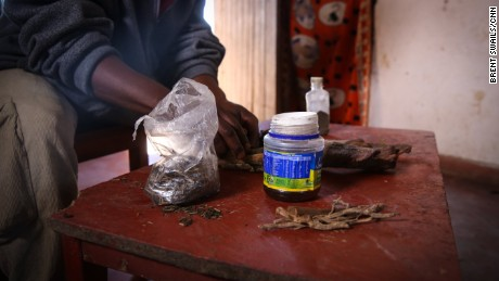 A traditional healer shows a mix of herbs that he uses to induce illegal abortions in Malawi.