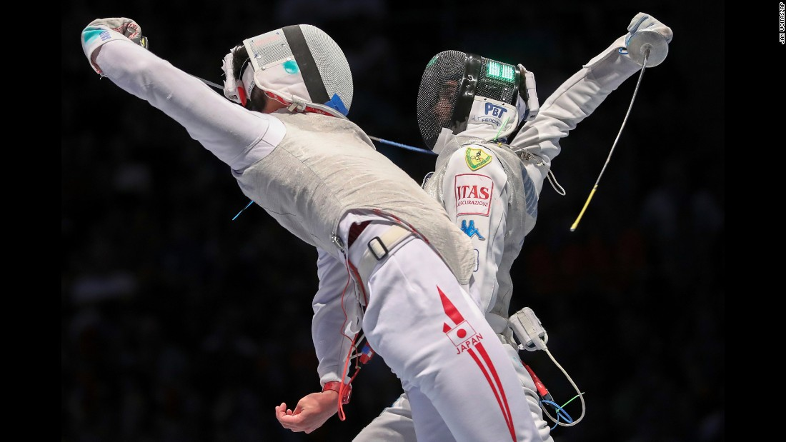 Japan's Toshiya Saito, left, competes against Italy's Daniele Garozzo at the World Fencing Championships on Sunday, July 23. Saito won 15-12 to advance to the final of the men's foil competition.
