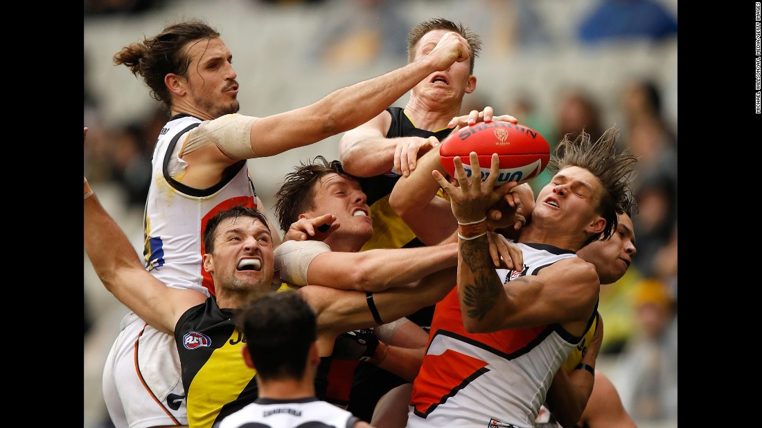 Players from the Richmond Tigers and the Greater Western Sydney Giants compete for the ball during an Australian Football League match on Sunday, July 23.