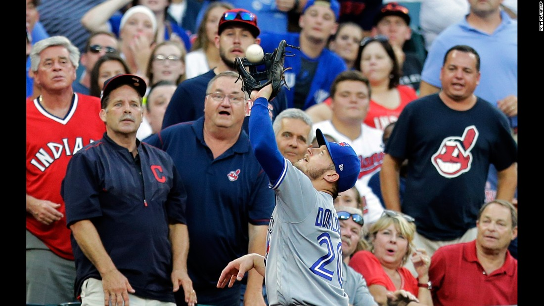 Toronto's Josh Donaldson catches a foul ball during a Major League Baseball game in Cleveland on Saturday, July 22.