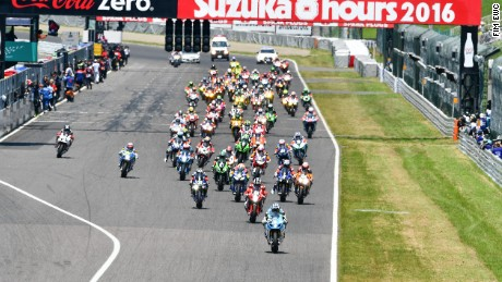 Riders stream away from the pit straight at the start of the 2016 Suzuka 8 Hours race.