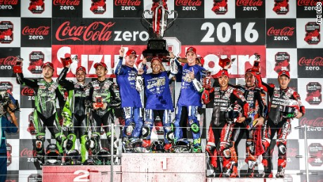 The victorious Yamaha team celebrate on top of the podium at the 2016 race.