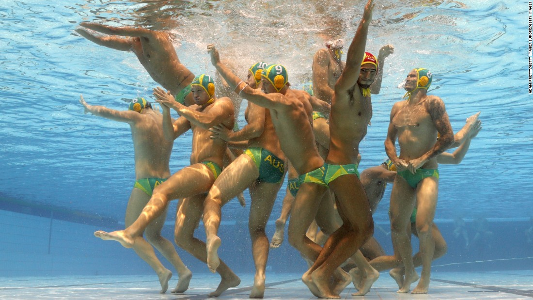 The Australian water polo team huddle during their match against Brazil. Named after Hungary's first Olympic gold medalist, the Alfred Hajós swimming complex will host all the water polo matches.